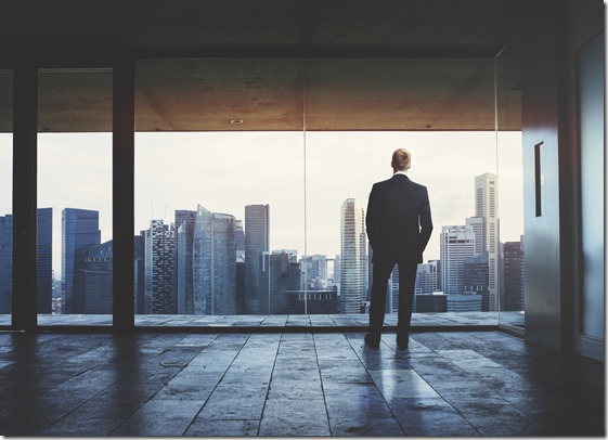 Businessman looking at city through window; Shutterstock ID 176015816; PO: LPX15962-01-01-0000; Job: Potentials for D.com; Other:  Alexa Steinberg